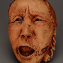 Dreamwork, Healing from shame, ceramic relief, head and face sculpture, wall hung, indoor, outdoor
