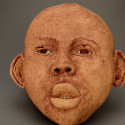 Child, Healing from shame, ceramic relief, head and face sculpture, wall hung, indoor, outdoor